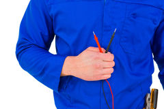 Electrician holding multimeter Stock Photography