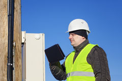 Electrician inspect electric lines. Technical quality Stock Photos