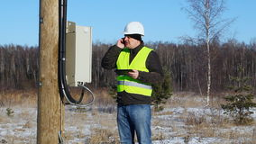 Electrician inspect electric lines technical quality Stock Images
