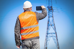 Electrician inspect the high-voltage power lines technical condition Stock Photos