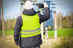 Electrician inspect the power lines technical condition. In summer day Royalty Free Stock Image