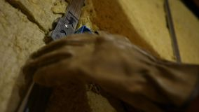 Electrician inspecting electrical lines in a box in unfinished basement.  stock video footage