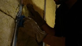 Electrician inspecting electrical lines in a box in unfinished basement.  stock video