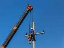 Electrician install wire on electric power pole with crane Royalty Free Stock Photos