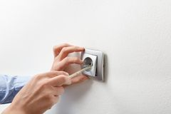 Free Electrician Installing AC Power Socket Stock Image - 53155901