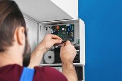 Electrician installing alarm system stock photos
