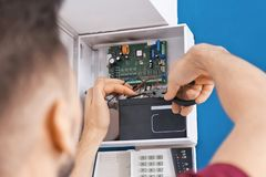 Electrician installing alarm system royalty free stock images