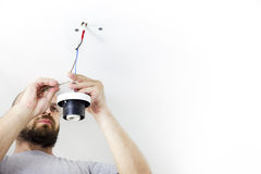 Electrician Installing Celling Light Royalty Free Stock Photography