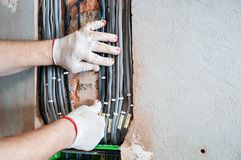 An electrician is installing electric wires royalty free stock photo