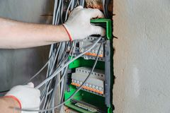 An electrician is installing electric wires. royalty free stock photo