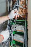 An electrician is installing electric wires. royalty free stock photography