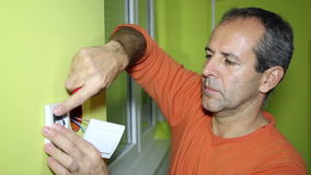 Electrician Installing an Electrical Switch stock video