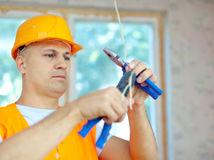 Electrician installing electricity Royalty Free Stock Image