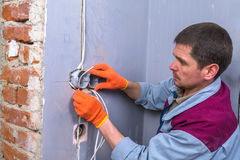 Electrician. Installing the electricity system Stock Photo