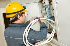 Electrician installing energy saving meter Stock Photos