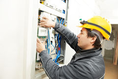 Electrician installing energy saving meter royalty free stock image