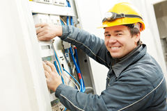 Electrician installing energy saving meter Royalty Free Stock Photos