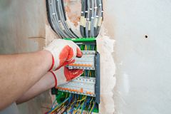 A electrician installing the fuses. royalty free stock photo