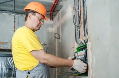 The electrician installing the fuses. stock photo