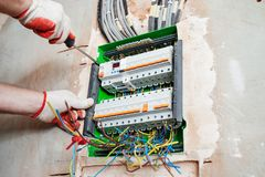A electrician installing the fuses. royalty free stock image