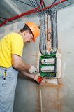The electrician installing the fuses. royalty free stock photo