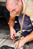 Electrician Installing in House. Electrician installing light in houses using tools and cords Stock Photos