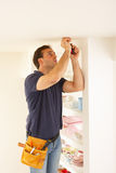 Electrician Installing Light Fitting royalty free stock image