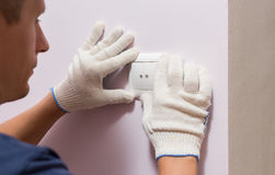 Electrician installing light switch, close up photo Royalty Free Stock Photo