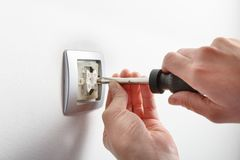 Electrician installing a light switch Stock Image