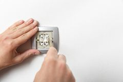 Electrician installing a light switch Stock Images