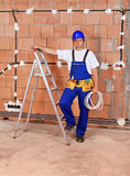 Electrician installing power cables in a new building Royalty Free Stock Photo