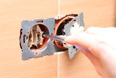 Electrician installing a power socket. Hand of an electrician installing a power socket Stock Photos