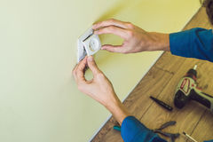Electrician Installing Socket In New House. Electrician in the house Royalty Free Stock Photo
