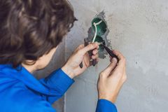 Electrician Installing Socket In New House Stock Photo