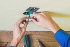 Electrician Installing Socket In New House Royalty Free Stock Photos