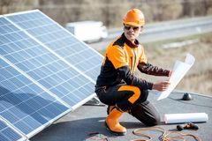 Free Electrician Installing Solar Panels Stock Images - 163528934