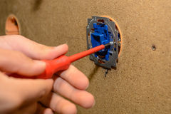 Electrician installing switch - close-up craftwork Stock Images