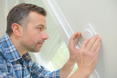 Electrician installing wall outlet Royalty Free Stock Photography