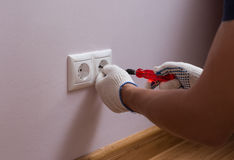 Electrician installing a wall power socket, close up photo Royalty Free Stock Images