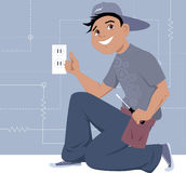 Electrician installing a wall socket Stock Photos