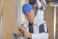 Electrician installing wires beforehand Stock Image