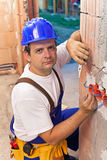 Electrician installing wires in a new building Royalty Free Stock Photos
