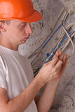 Electrician insulating the electric wires Stock Images