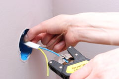 Electrician insulating electric wires Stock Image