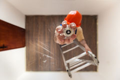 Electrician Is Mounting A Bulb Royalty Free Stock Photography