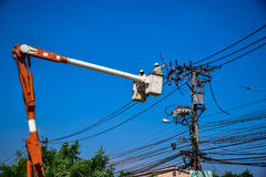 Team worker repairing work on electric post power pole Stock Images