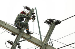 Electrician lineman repairman worker at climbing work Stock Image