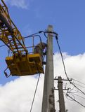Work on electric post power pole Electrician lineman repairman worker at climbing Stock Image