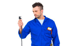 Electrician looking at plug Royalty Free Stock Images