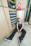 Electrician lying on the ground Royalty Free Stock Photos